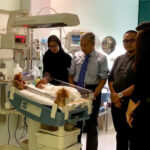Concerned Dr M Pays Surprise Visit to Baby Ainul in London